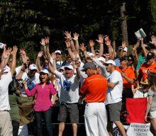 Volunteers cheering at tournament